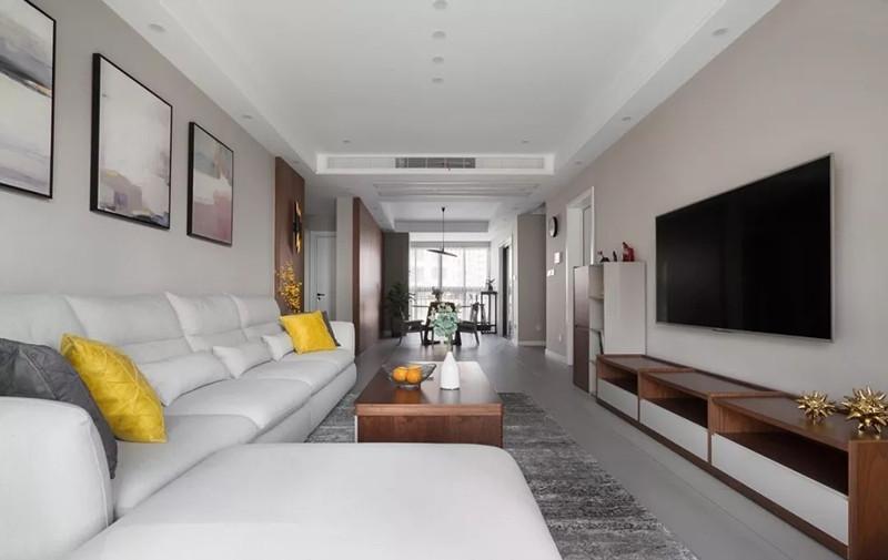 明亮的白,平和的灰,温润的原木饰面贯穿整个空间,别致的灯具为空间画龙点睛。木饰面墙与浅灰水泥砖地面相结合,给人以沉稳、宁静的自然质感。