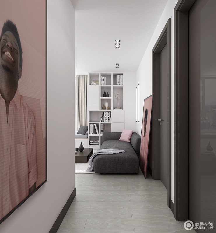 走廊虽然设计得十分简单,但是,浅灰色砖石的素朴让空间十分利落;而粉色调的人物画,让空间更有生机和艺术格调。