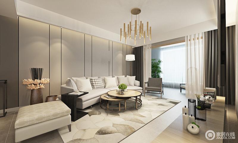 客厅运用不同层次的灰色主打空间,沙发墙上黑色线条切分出沉稳灵动的视感,烘托着弧形多人布艺沙发;香槟金线条灯悬挂在折叠金属茶几上方,材质呼应出轻奢情调,在轻快活泼的地毯映衬下,敞阔空间有着内敛的浪漫气息。