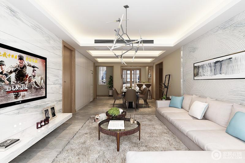 整个空间矩形的吊顶因为灯带渲染出了强烈的几何效果,让天花也具有立体层次,金属管灯以工业精致提升了空间的时尚感;灰色地砖与白色灰纹电视墙呈色彩对比,让空间简单却利落,白色沙发和驼灰色地毯带来温和,而精致的圆几更填趣意,并与沙发背景墙上的挂画让空间和谐而具有艺术气息。