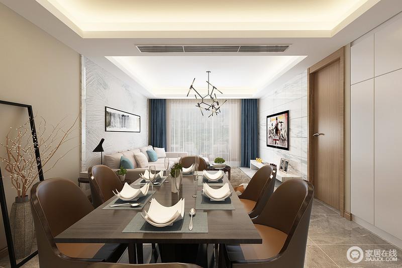 一体式空间给视觉带来一种宽阔感,驼色漆的墙面与白色收纳柜对比出色彩美学,而灰色地砖以几何块的形式,尽显整洁大气;实木餐椅的半圆造型尽显现代庄雅,精致的餐盘与干花营造了一种意境感的生活。
