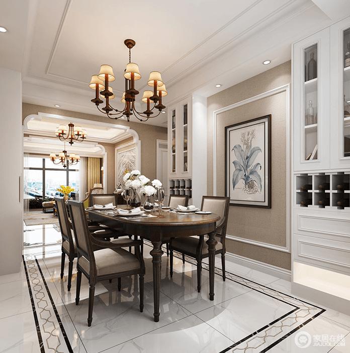 餐厅选用深色木质餐桌,与驼灰色的墙面搭配出安静且沉稳的氛围,让人倍感温馨;白色酒柜和植物装饰画缓解餐厅的深沉氛围,更填一丝纯雅,美式吊灯统一玄关在吊顶,让空间明快中散发着复古之美。