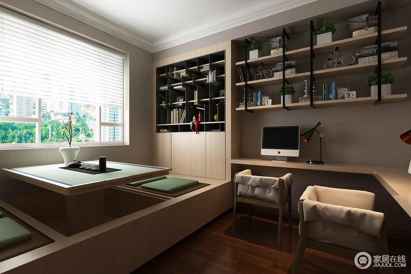 书房结构规整得体,设计师以灰色漆粉刷壁纸,与褐色地板增加空间的沉稳;根据空间需要嵌入式定制设计以几何样式,彰显了收纳美学,却不显得更具现代工业气息;实木榻榻米升降设计实用率高,与实木布艺的时髦,尽显生活的智慧。