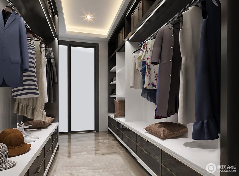 衣帽间以实用为主,从定制得衣柜便可以看出主人有条有理的生活节奏;衣帽间运用黑色、白色搭配,简单明了,再加上淡淡的暖色灯光,整个衣帽间简洁大方,不显繁琐。