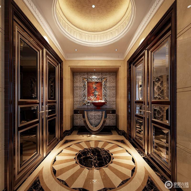 玄关利用圆的造型,让饰以典线的天花板和地面拼花,上下辉映出奢华富丽格调;内嵌的背景墙上装饰画框描银雕花,色调丰满热情,与边柜搭配出摩登视感;而两侧对称的玻璃门饰,在描金线条的多重勾勒下,呈现轻奢华贵。