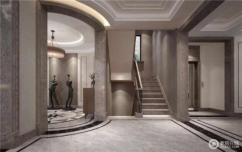 从门厅出了便是楼梯,直通二楼,门框采用大理石,增加空间结构感;而灰色漆的粉刷,无形中与石材楼梯构成朴质,让空间多了份天然美学。