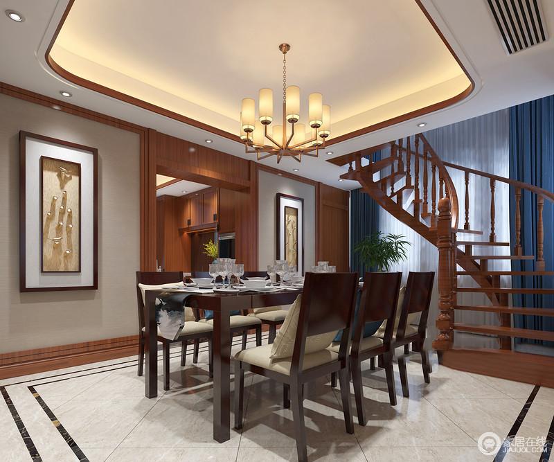 餐厅因为曲线旋转式楼梯更富结构动感,原本驼色的墙面和白色的吊顶,因为实木踢脚线和顶线的装裱,让空间具有了面妆感;中式挂画地点缀,搭配新中式家具营造温馨。