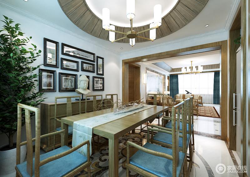 明式风格的餐桌椅素简内敛,自带一份清雅自然,搭配出富有和谐平衡的挺拔,让就餐氛围平和沉静;盆栽绿植盎然点缀在边柜一旁,佛像面相圆润丰满、敦厚慈祥,而墙上黑白照片则色淡蕴浅,空间庄重但富有灵性。
