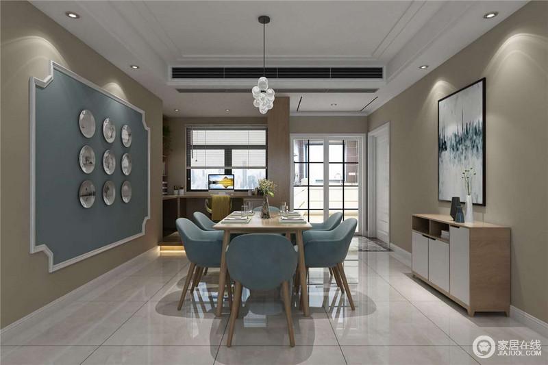 餐厅的米色调因为增加了蓝色造型墙变奏出了空间的色彩魅力,餐盘装饰多了手工艺的质感;原木餐桌的木色与餐椅的蓝色应和着空间的主基调,将清暖与淡静合并出生活的雅致。