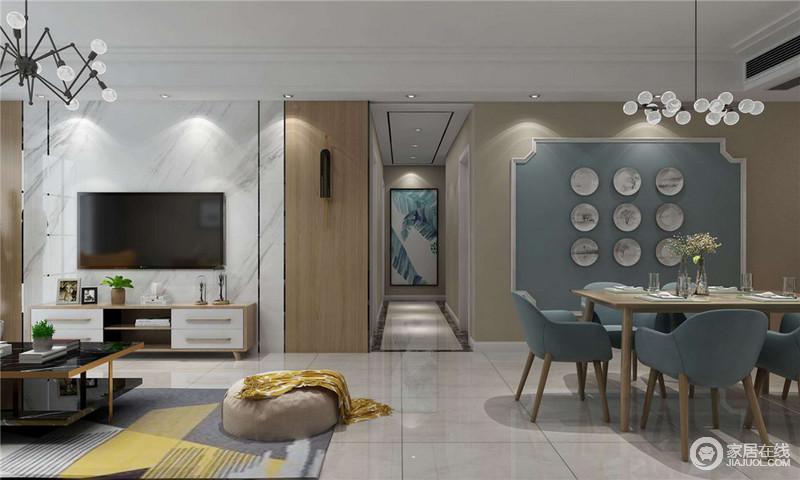 客厅的背景墙以白色砖石和板材为主,构建了墙面的自然基调,让空间平静中蕴藏着材质之美;走廊因为地砖的原因多了几何效果,再加上挂画的清新,无不展示着设计的讲究。