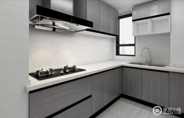 厨房作为每日的烹炒煎炸的空间,以冷色调示人,让人在下厨的时候不会感觉到太多的燥气。灰色布纹橱柜搭配白色大理石台面十分干练,营造出材质带来的雅致。