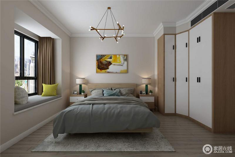 卧室虽然整体色调比较中性,但是从一副彩色挂画的设计中,便可感受到生活的明媚与活力;对称的家居陈列方式,和谐之中,也与衣柜形成整体感;灰色床品十分柔软,让睡眠质感更高;而黄铜吊灯带着工业艺术,让空间具有时尚气息,再加上飘窗处的绿色靠垫,点缀出摩登。