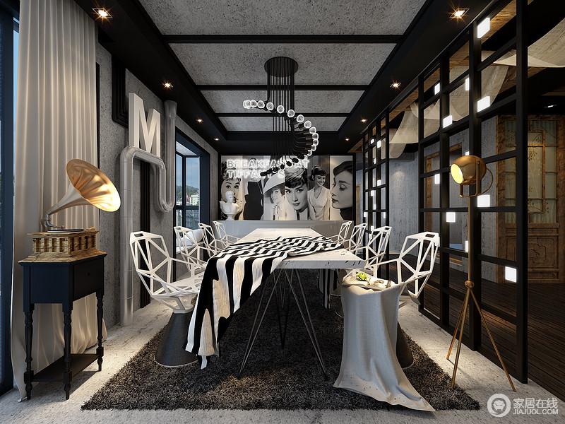 餐厅有着多趣多味的姿态,看似因灰色仿古砖和裸露的实木结构而工业风浓重,但是新古典边柜上的黄铜的留声机带你体会古式雅致的生活;个性白色餐椅在黑色地毯的衬托中,与黑白条纹餐补彰显摩登。