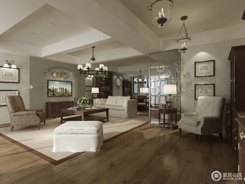 客厅的矩形石膏吊顶加重了空间的结构美学,隔断巧妙划分了空间,也增加了区域性;豆绿色的涂料粉刷在墙面,与实木地板构成自然之调,在呦中性色的沙发和地毯作为辅助,让空间愈加温和大气。