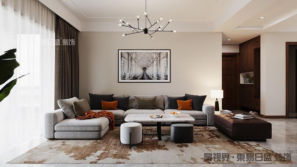 沙发上放上几个橙色抱枕,一条毯子,不失为一处亮点。