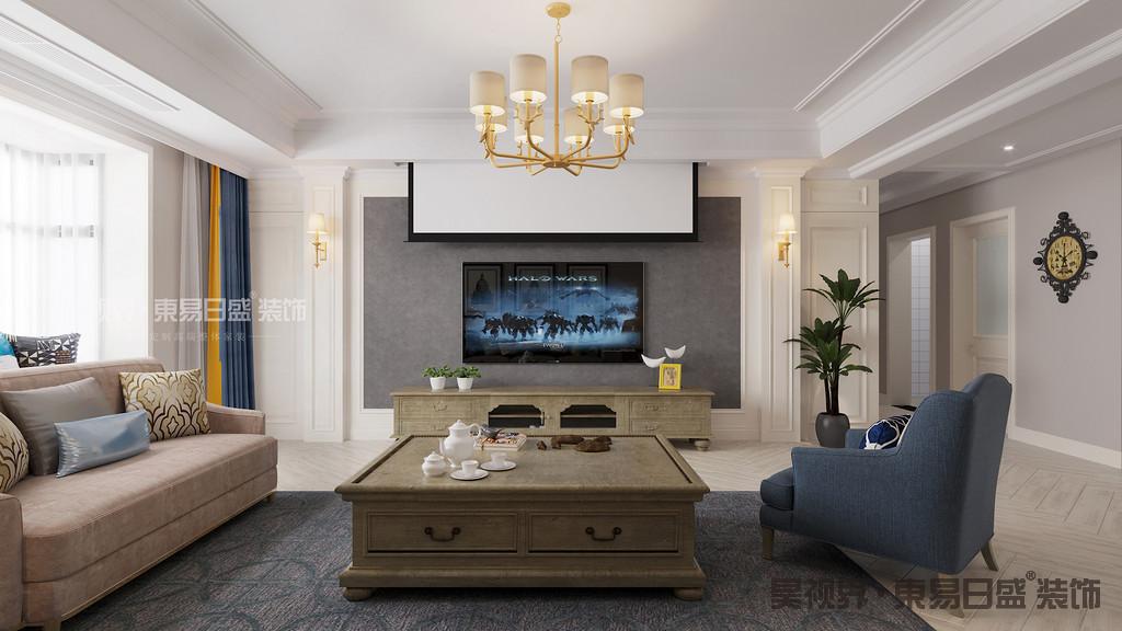 客厅以浅灰色与白色为主色调,柔和中带来些许沉稳,墙面搭配浅驼色的沙发,优雅而不失质感。灰蓝色沙发与地毯相映成趣,打造出客厅的别样风味。