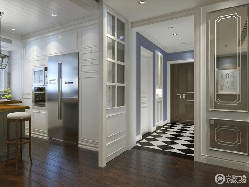 入户门厅的走廊上,设计师在地面上特意铺贴了黑白菱形地砖,彰显出的气质瞬间提升了空间格调;墙面蓝色大面积诠释,深邃宁静中不乏功能设计;内嵌入墙的玄关柜,与卫生间门搭配的和谐简洁。
