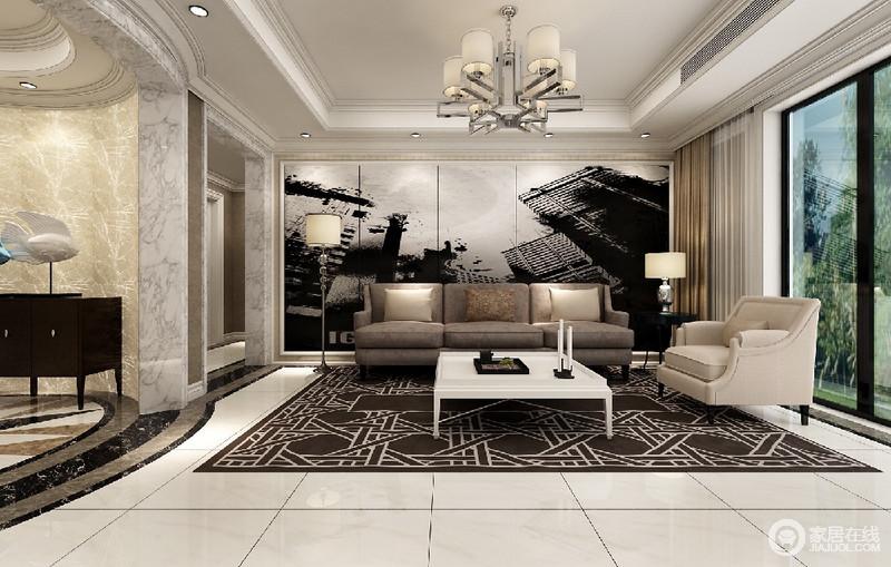 客厅在灰黑白空间中,加入了深咖和米色,彰显出沉稳的调性;大面积抢眼的沙发墙,将大都市的深邃感,释放融入到空间中。