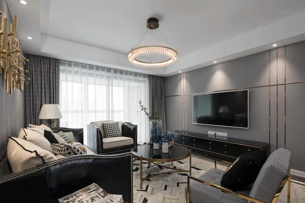 客厅以大面积的灰色海吉布为整个空间增添格调,绝佳的采光性加以丰富考究的灯光设计,营造高端明亮的空间氛围。