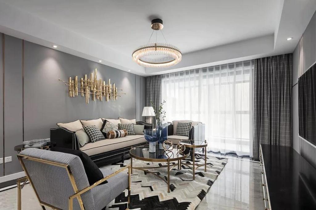 背景墙由金属线条分割,带来精致利落的视觉感。充满优雅时尚气息的地毯,与空间主色调相互呼应,相辅相成。