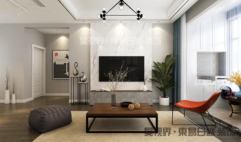 白色的墙面、白色的家具和搭配深色沙,让客厅看上去格外简洁开阔。