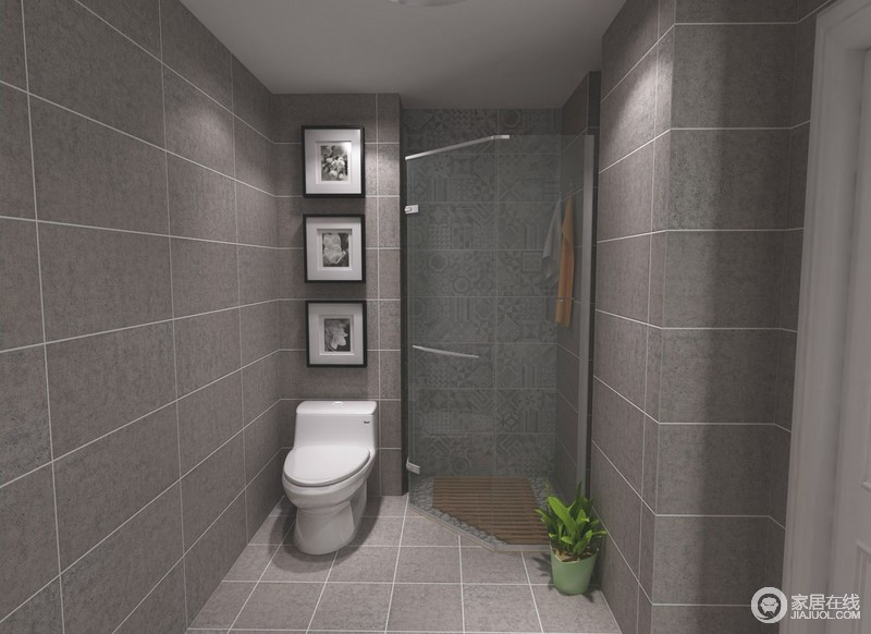卫生间虽然不大,但是玻璃淋浴房设计在转角处,巧妙地提升了空间的利用率,并通过玻璃房解决干湿问题;白色洁具搭配灰色砖石,再加上黑白画作点缀,让空间更有层次,也愈加整洁。