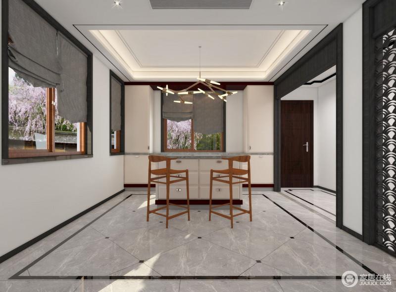 空间以白墙与黑色木材框建空间,看似开放却自有格局;鱼鳞状的镂空屏风将东方的祥意释放在空间,与灰色地面营造素静;岛台兼具餐桌的功能,因为黄铜管灯、实木高脚凳多了现代时髦。