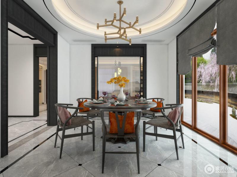 空间以白色为主,黑色门框和玻璃隔断结构强化了黑白时尚,圆形穹顶与之构成空间的建筑美学;灰色地砖以菱形的方式铺设,并因为小黑砖的点缀多了动感,黑胡桃圆桌与餐椅带着中式禅意,让空间利落之余,更富东方格调。