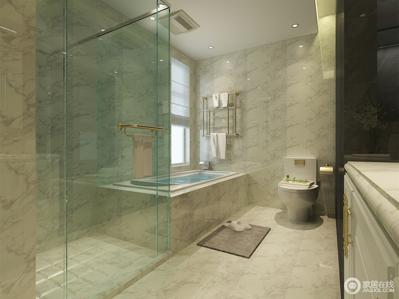 卫生间动静线划分清晰,盥洗柜与隔断墙的黑白对比,增添时尚感;浅蓝色的玻璃隔离出淋浴区,有效保证空间的干湿分离;整体墙面采用质感光洁的灰色大理石,让空间的通透感强,繁杂的肌理避免了空间的单调感。